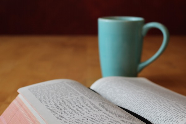Open Bible and cup of coffee